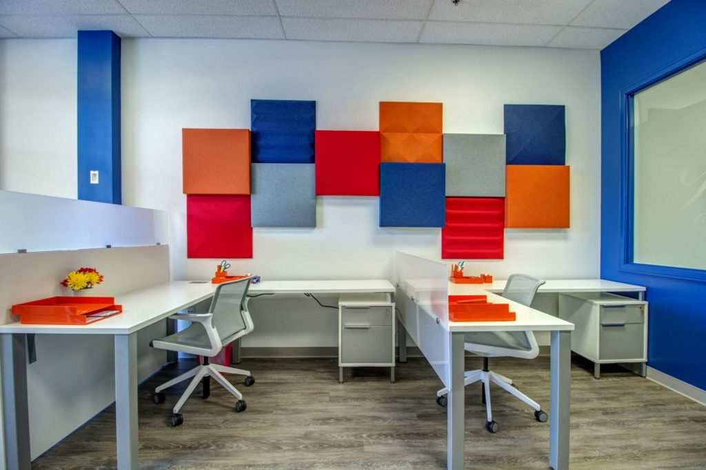 Office setting with colorful acoustical panels on the wall