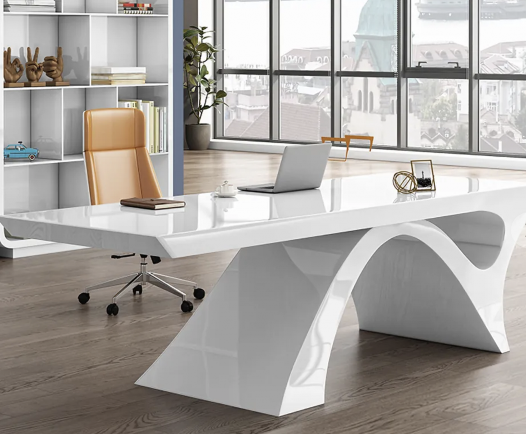 A large white desk with sculptural legs
